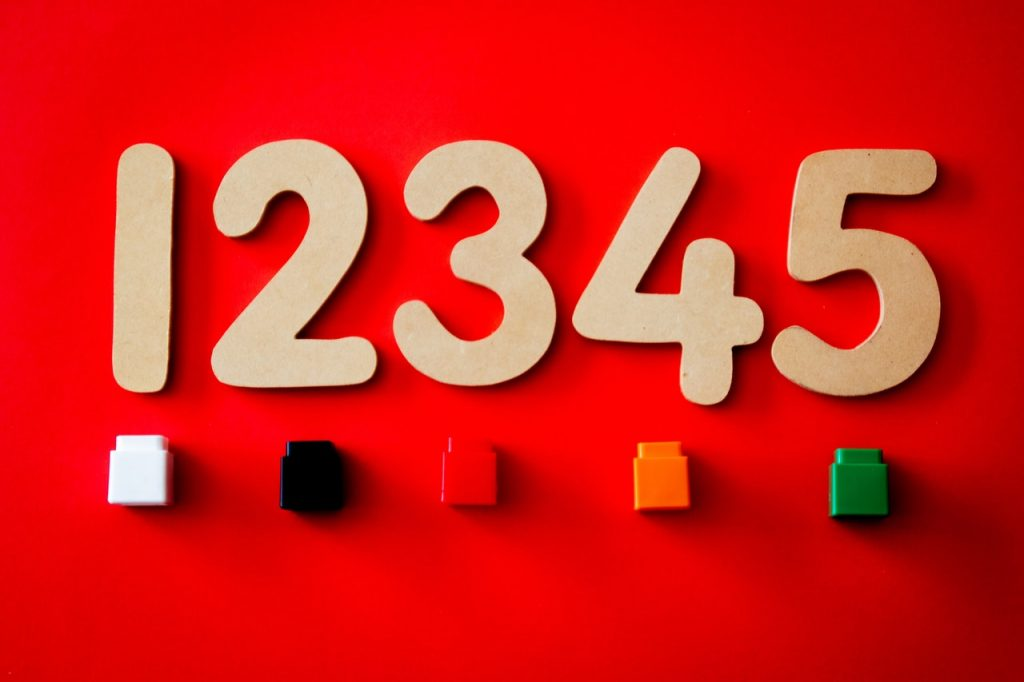 Wooden numbers and plastic blocks