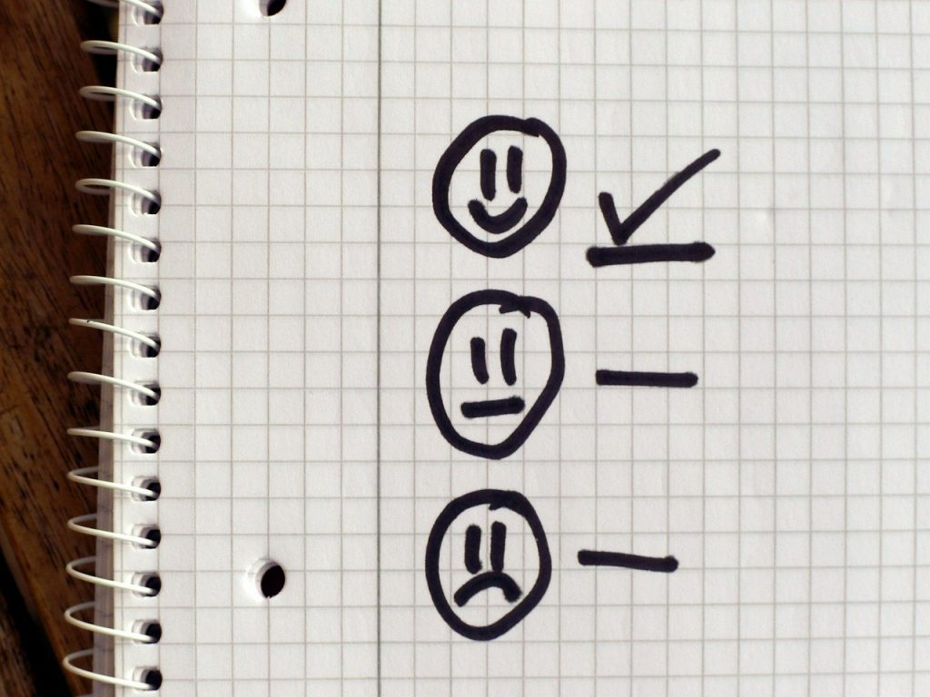 Doodle of three faces with a checkmark beside the first
