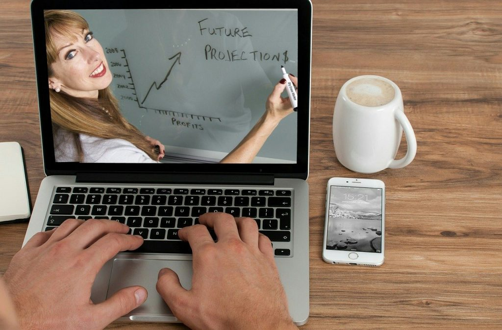 Laptop with image of woman conducting eLearning course