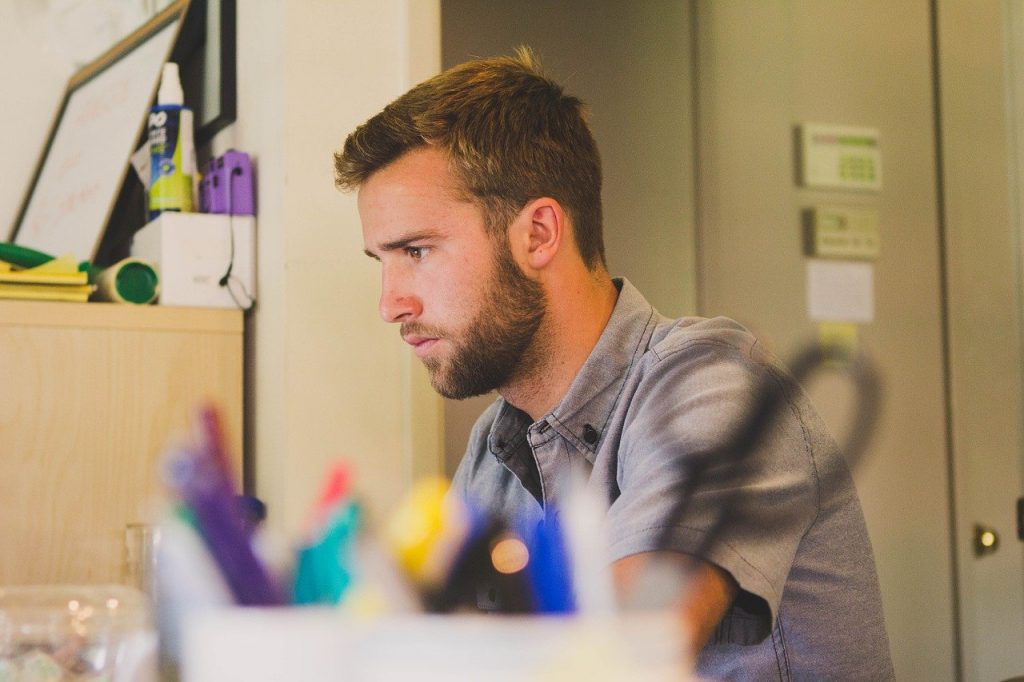 Man with a beard working in an office