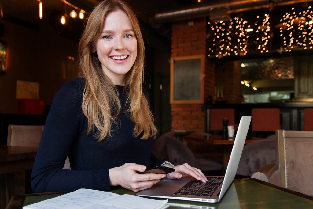 Attractive young woman working on a laptop