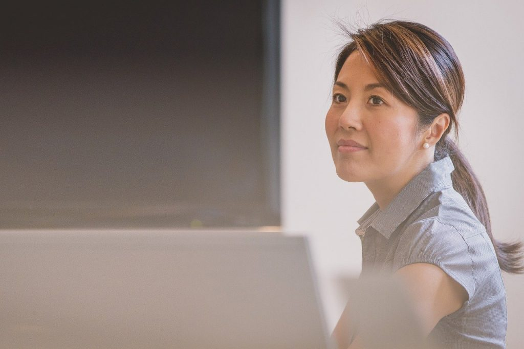 Candid photo of an Asian woman working in an office