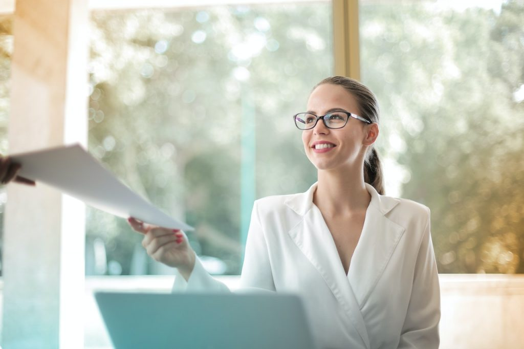 Woman working on double spaced document