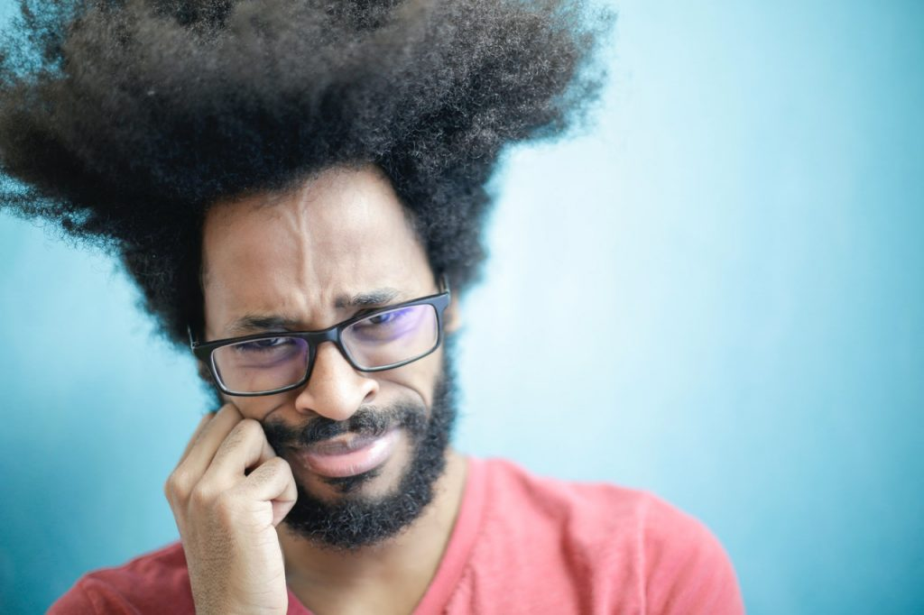 Black man wearing glasses appears to be confused