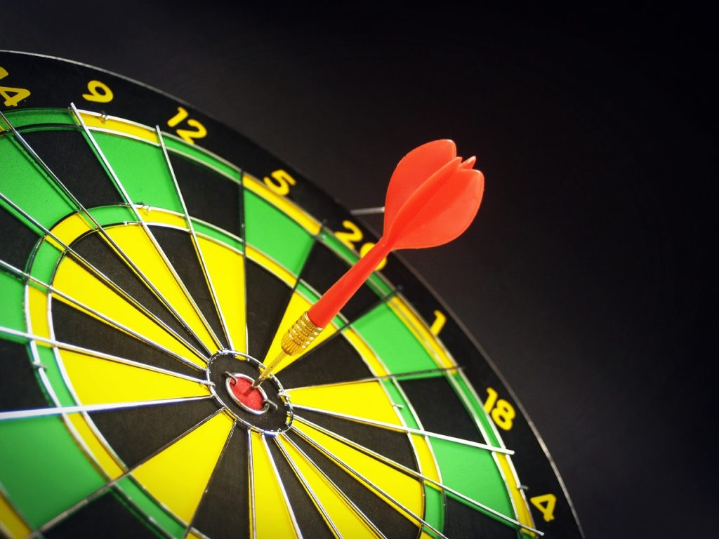 Dart board with a dart in the center
