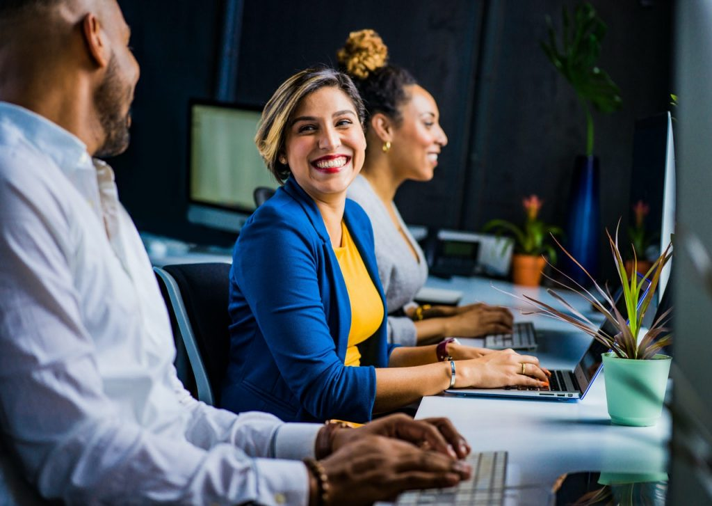 Smiling woman has discovered free online Excel training