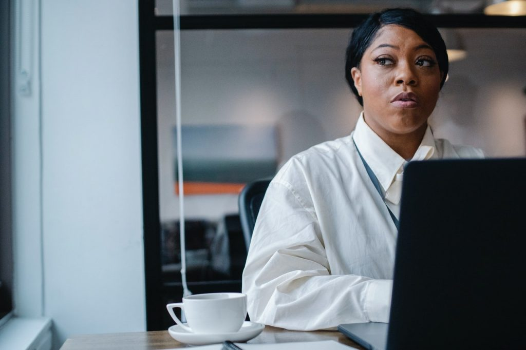 Black business woman working at a computer