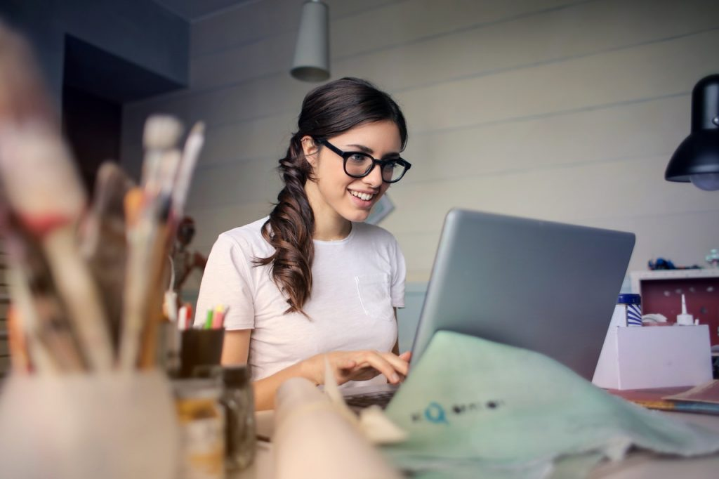 Attractive woman with glasses using laptop